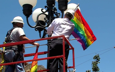 Kevin Faulconer Hoisting Pride Flag in Gaslamp Quarter